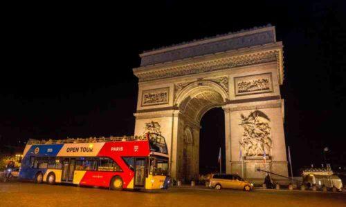 bus touristique à Paris by Night