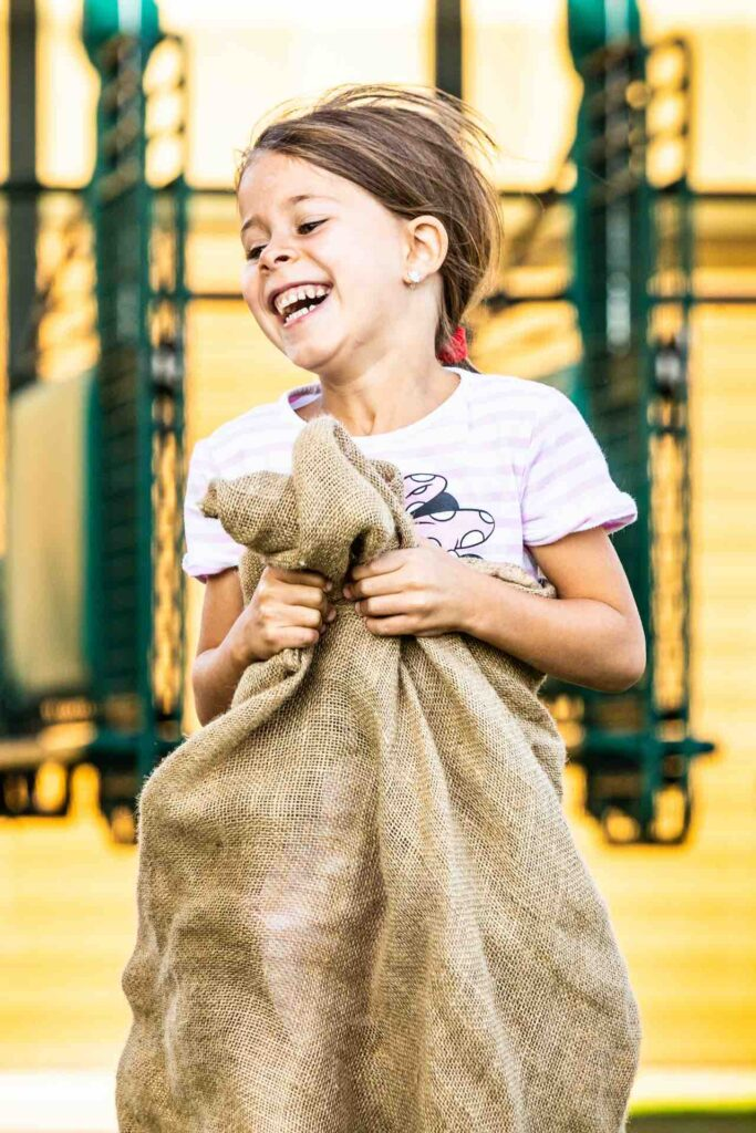sack jumping, free family entertainment at the racetrack